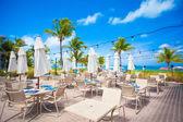 Outdoor cafe on tropical beach — Stock Photo