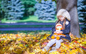 Cute little girl at warm sunny autumn day outdoor — Stock Photo