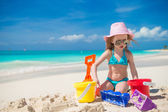 Adorable little girl playing with beach toys during carribean vacation — Stock Photo