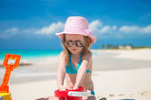 Little girl playing with beach toys during carribean vacation — Stock Photo