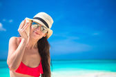 Portrait of woman with seashell in hands at tropical beach — Stock Photo