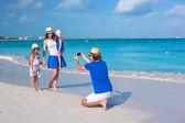 Happy family on caribbean holiday vacation — Stock Photo
