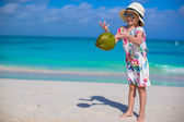 Adorable little girl with coconut at white beach have fun — Stock Photo