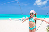 Adorable little girl have fun on a yacht during caribbean vacation — Stock Photo
