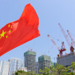 Flag of China in front of buildings under construction — Stock Photo