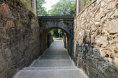 Stone footpath between stone walls — 图库照片