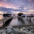 Boat dock at sunset with raised boats and jet ski's, Minnesota, USA - Foto Stock