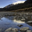 Stock Photo: River valley with reflection of snow capped mountain. Southern Alps, Queenstown, south island, New Zealand