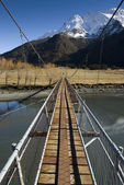 Swing Bridge crossing the Matukituki River. Mount Aspiring National Park. South Island, New Zealand. — Stock Photo