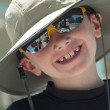 Smiling young boy wearing a hat. — Stockfoto
