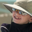 Smiling young boy wearing a hat. — Stock Photo