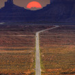 Digitally created image of a roadway leading to Monument Valley — Stockfoto
