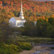 Fall foliage behind a rural Vermont church — Stock Photo