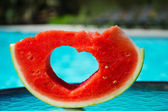 Watermelon with Heart shape by the pool — Stock Photo