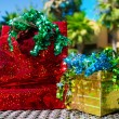 Gift bag, box and ribbon by the swimming pool — Stock Photo