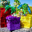 Gift bags and box with ribbon by the swimming pool — Stock fotografie