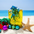Stock Photo: Starfish with Christmas balls and gifts - holiday concept