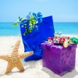 Stock Photo: Starfish with gifts on beach