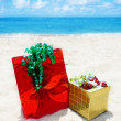 Stock Photo: Gift box and bag on beach - holiday concept