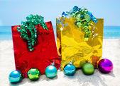 Gift bags with Christmas balls - holiday concept — Stock Photo