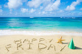"Sign ""Happy Friday"" on the sandy beach — Stock Photo"