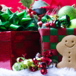 Gingerbread man by the gift box — Stock Photo