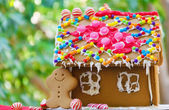 Gingerbread man by the house — Stock Photo