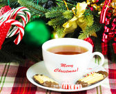 Tea with Christmas candy — Stock Photo