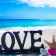"Stock Photo: Sign ""Love"" with heart shapes and starfish"