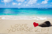 "Sign ""Love yourself"" on the sandy beach — Stock Photo"