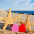 Starfishes with hearts on sandy beach — Stok Fotoğraf #39070001