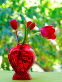 Tulip with heart in the vase — Stock Photo