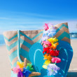 Beach bag with flip flops by ocean — Stock Photo #41240689
