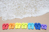 Color flip flops by the ocean — Stock Photo