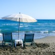 White Beach Umbrella and Chairs — Stock Photo #49144965