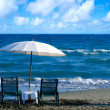 White Beach Umbrella and Chairs — Stock Photo #49144977