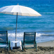 White Beach Umbrella and Chairs — Stock Photo #49144987