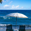 White Beach Umbrella and Chairs — Stock Photo #49144989
