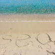 Word sea written on the sand — Stock Photo