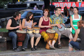Street musicians playing the drums — Stock Photo