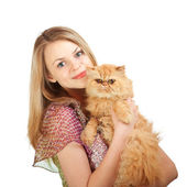 The nice girl with a red cat on hands — Stockfoto