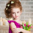 Portrait of a beautiful girl with flowers - Stock Photo