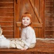 Little girl on the porch — Stockfoto