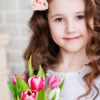 Stock Photo: Beautiful girl with tulips