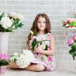 Beautiful girl with flowers — Stock Photo #25058365