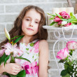 Beautiful girl with flowers — Stock Photo #25058367
