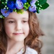 Beautiful little girl in a wreath — Stock Photo