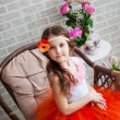 Little girl with flowers — Stock Photo