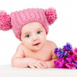 Beautiful baby in the hat with flowers — Stock Photo #25058505