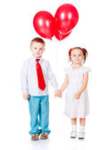Boy and girl with the red balloons — Stock Photo